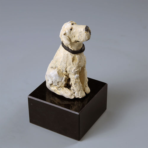 Small ceramic sculpture of a yellow Labrador dog