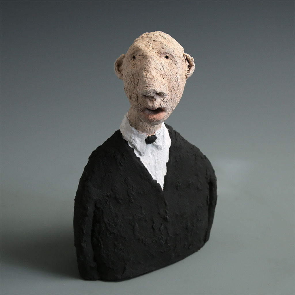 Ceramic singer sculpture finished in stains & underglazes