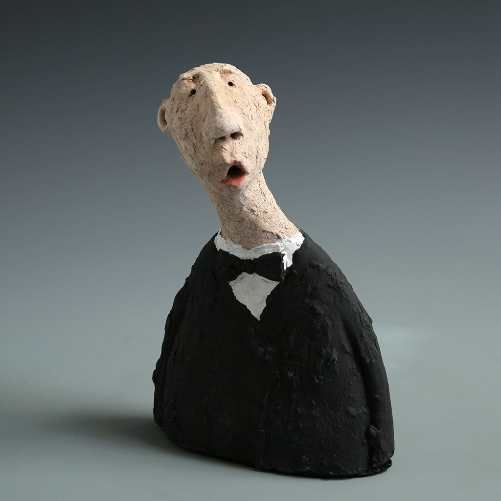 Ceramic singer sculpture