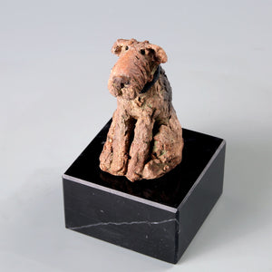 Small ceramic sculpture of a Welsh Terrier