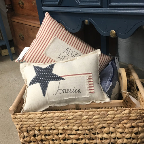 Pillows sitting in a basket