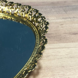 closeup of gold rimmed vanity mirror