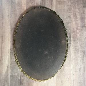back of gold rimmed vanity mirror