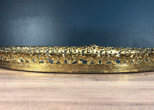 side view of gold vanity mirror