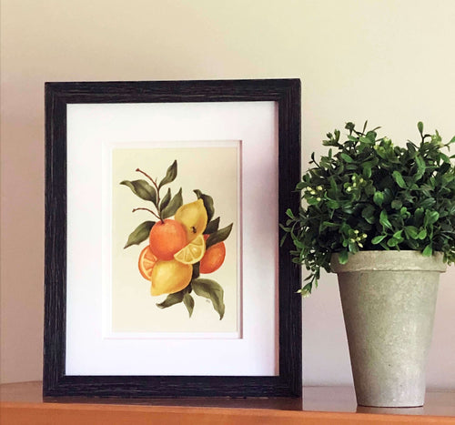 framed art print of lemons and oranges