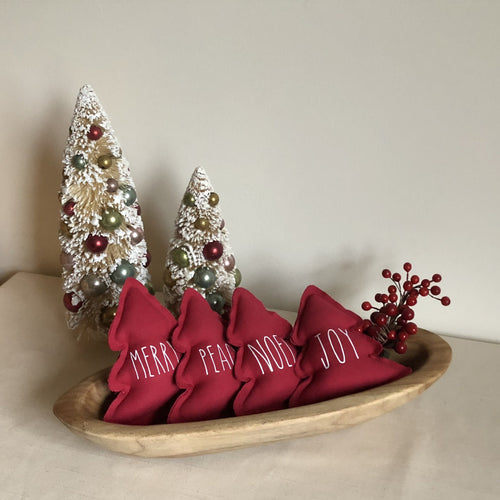 red fabric trees in a bowl