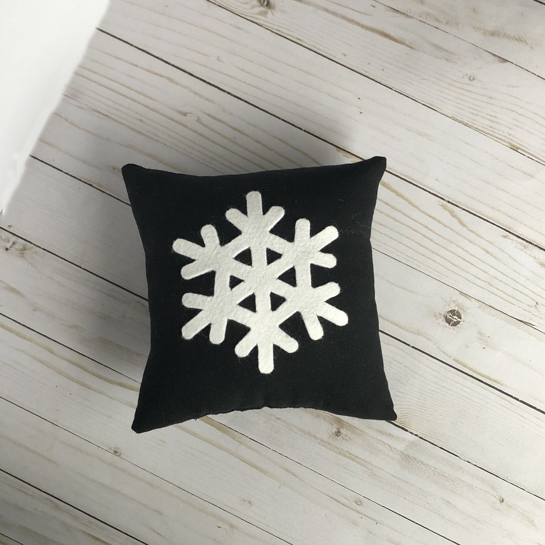 black pillow with snowflake