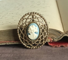 gold brooch with blue cream cameo