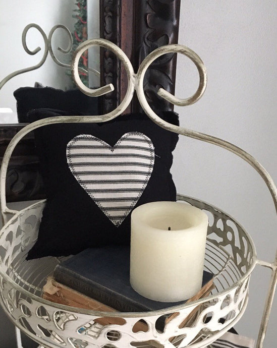 small black pillow with striped heart