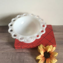 milk glass dish on a book