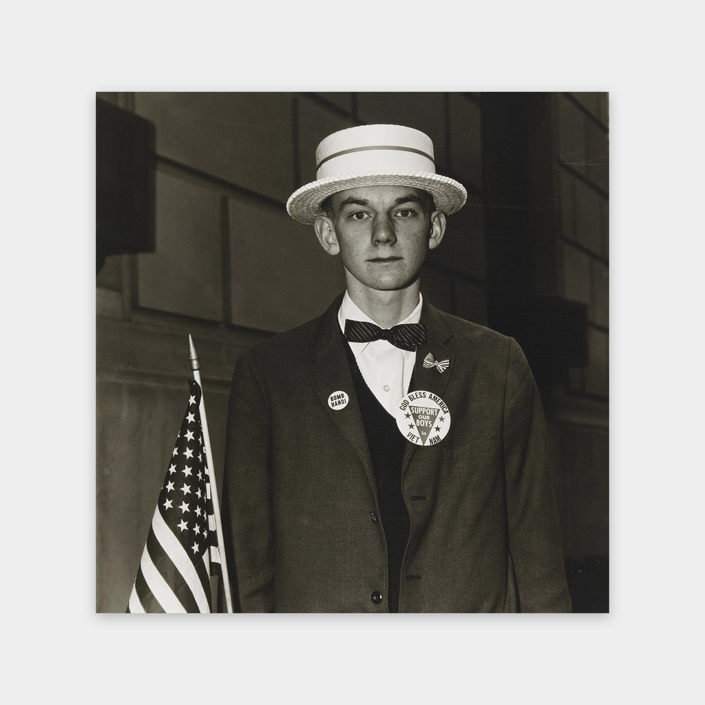 Diane Arbus, Boy with Straw Hat Waiting to March in a Pro War Parade, New York, NY 1967