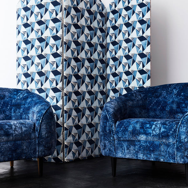 Sitting room with blue printed velvet chairs