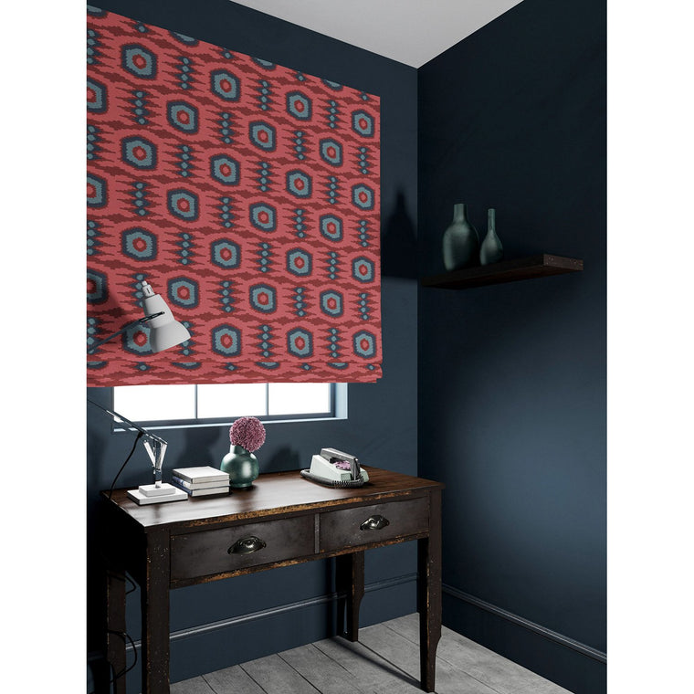 Velvet blind in a red and blue velvet fabric with stain resistant finish and abstract print