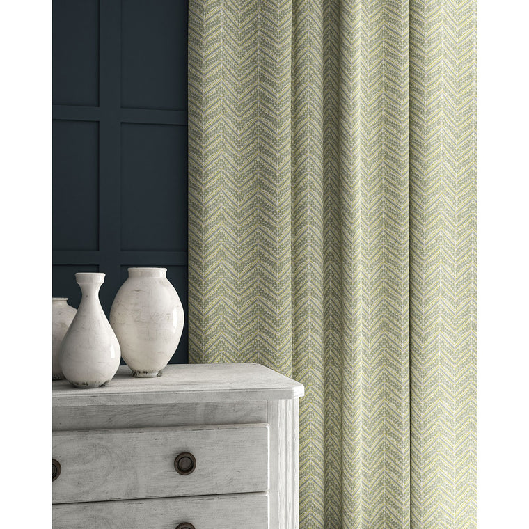 Curtains in a light coloured zig zag geometric weave fabric