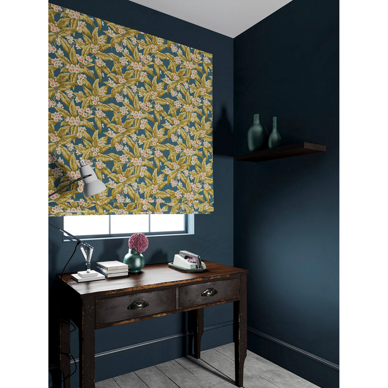 Velvet blind in a blue and ochre coloured velvet fabric with a leaf and blossom design and stain resistant finish