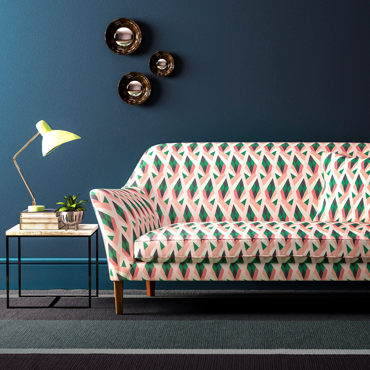 Velvet sofa upholstered in a geometric velvet upholstery fabric in peach and green colours with a stain resistant finish