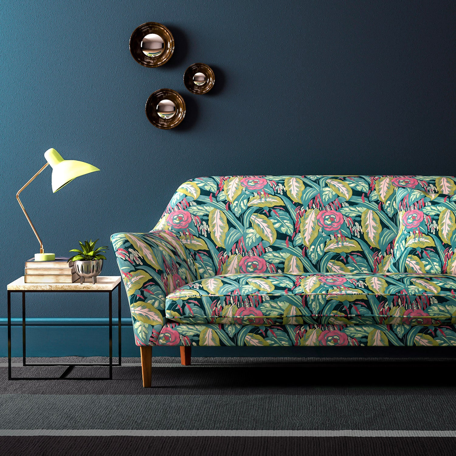 Velvet sofa upholstered in a pink and teal floral velvet upholstery fabric with a stain resistant finish