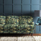 Velvet sofa upholstered in a green velvet upholstery fabric with green tree design and stain resistant finish