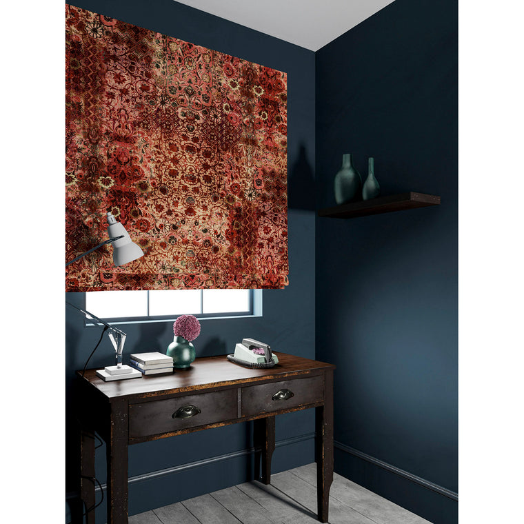 Velvet blind in a fabric with a carpet design in rich terracotta tones