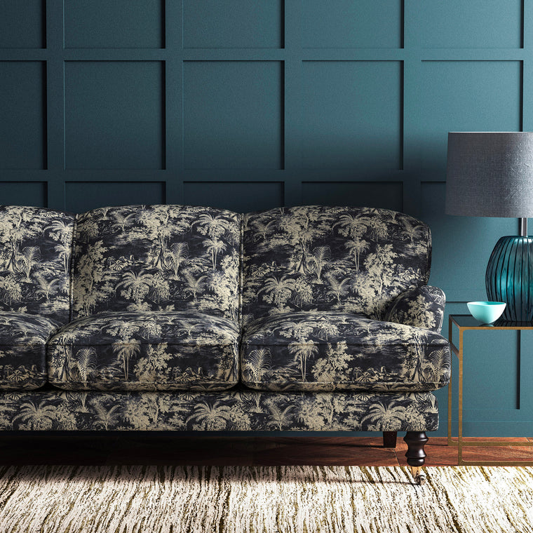 Velvet sofa upholstered in a grey and white velvet upholstery fabric with palm tree design and stain resistant finish