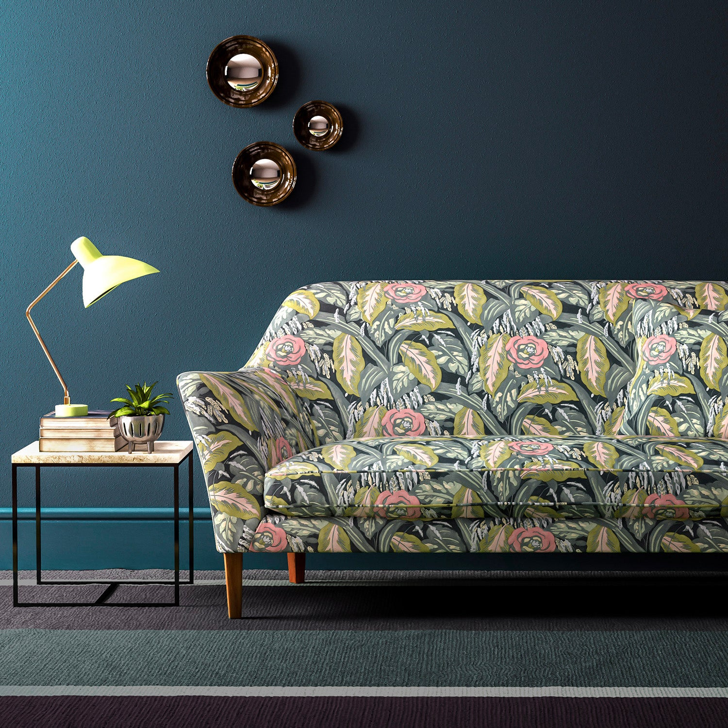 Velvet sofa upholstered in a pink and smokey blue floral velvet upholstery fabric with a stain resistant finish