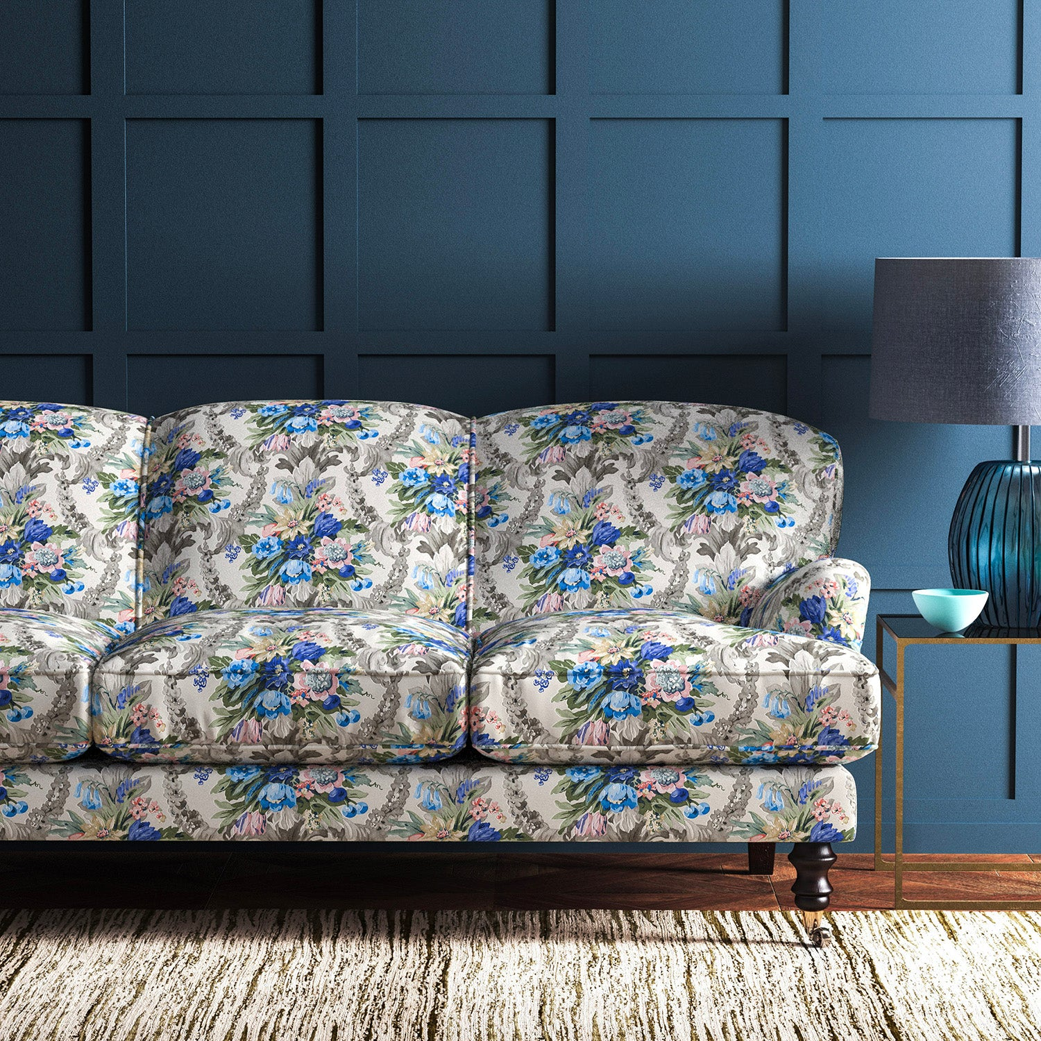 Sofa upholstered in a velvet upholstery fabric with stain resistant finish and vibrant colourful flower bouquet
