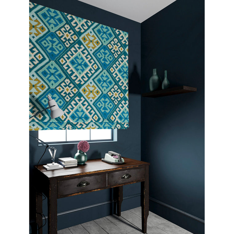 Velvet blind in a velvet fabric with stain resistant finish and kilim design in blue tones