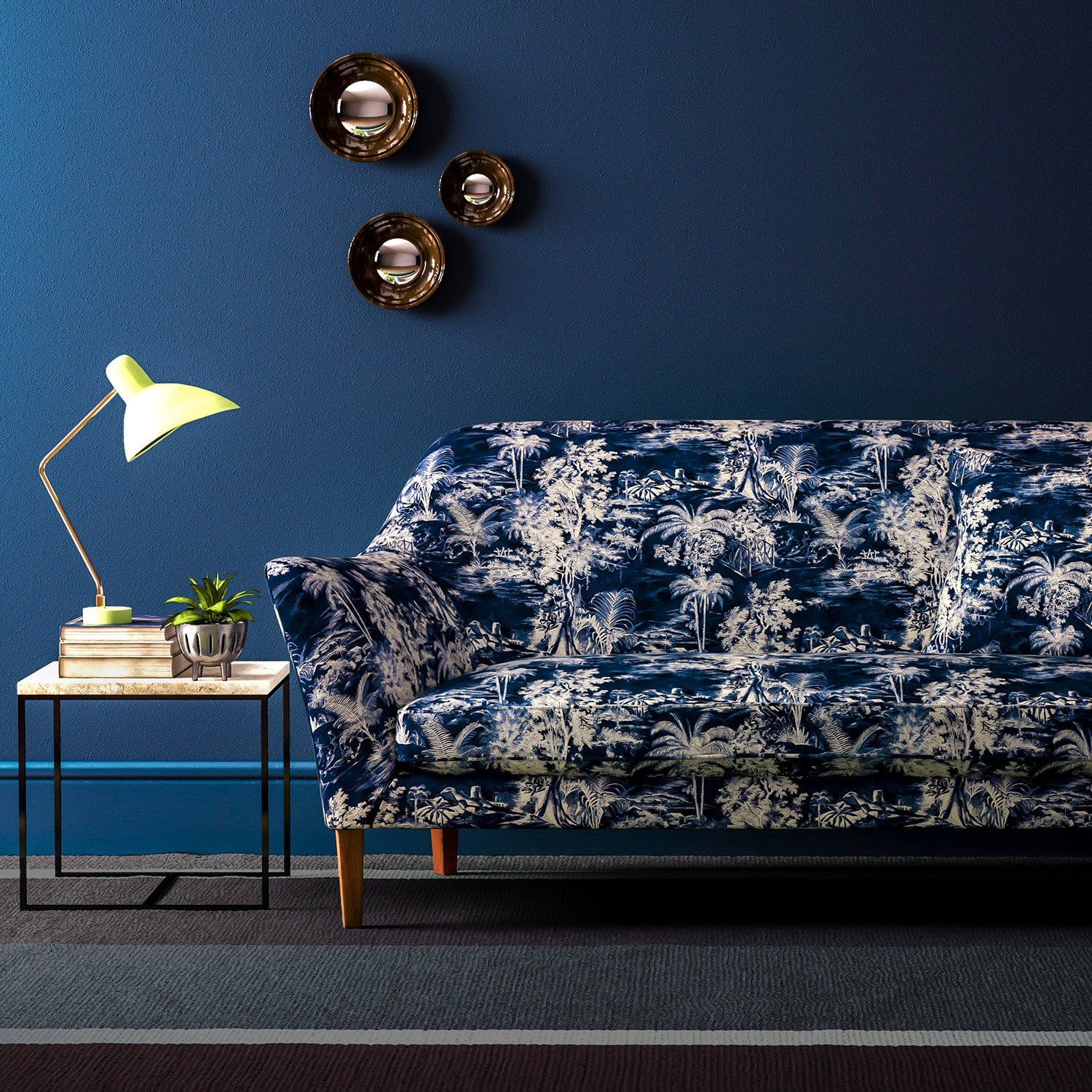 Velvet sofa upholstered in a indigo blue and white velvet upholstery fabric with palm tree design and stain resistant finish