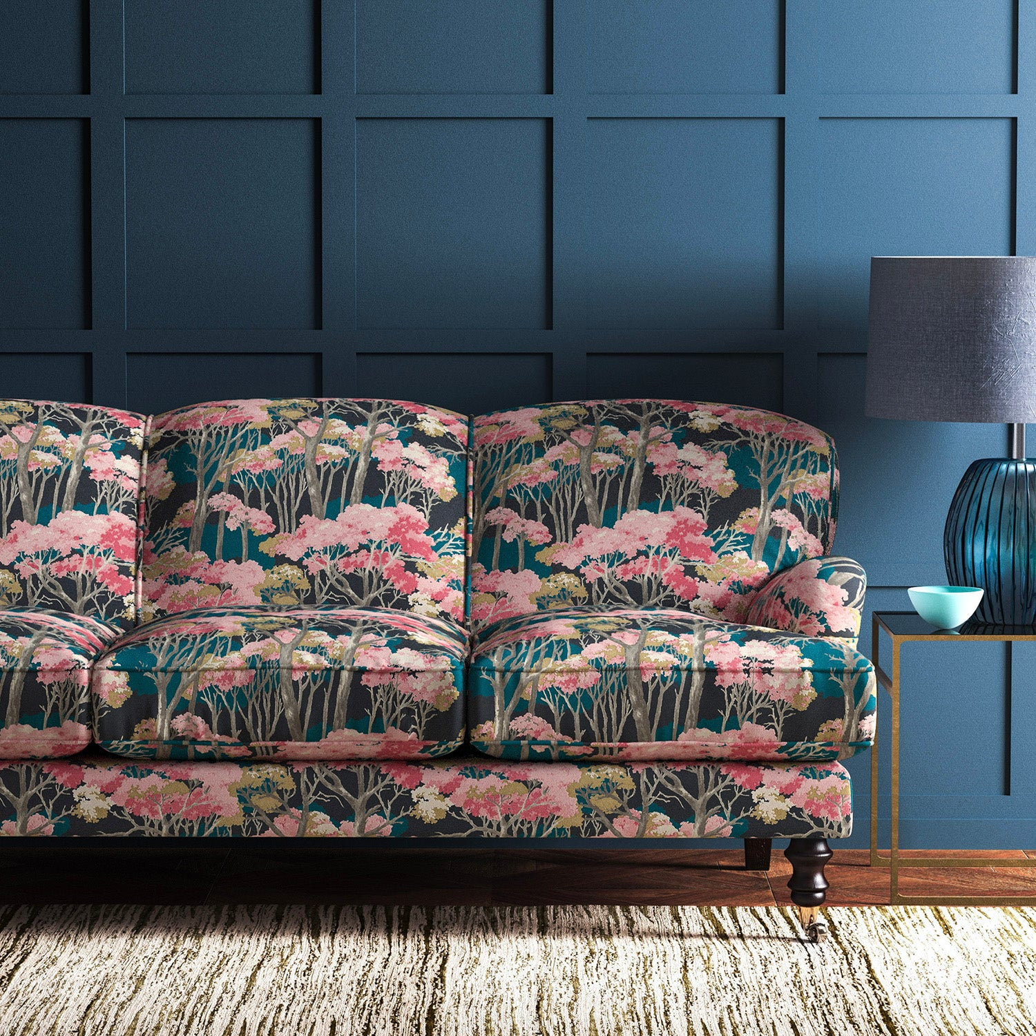 Velvet sofa in a pink and blue velvet fabric with tree design