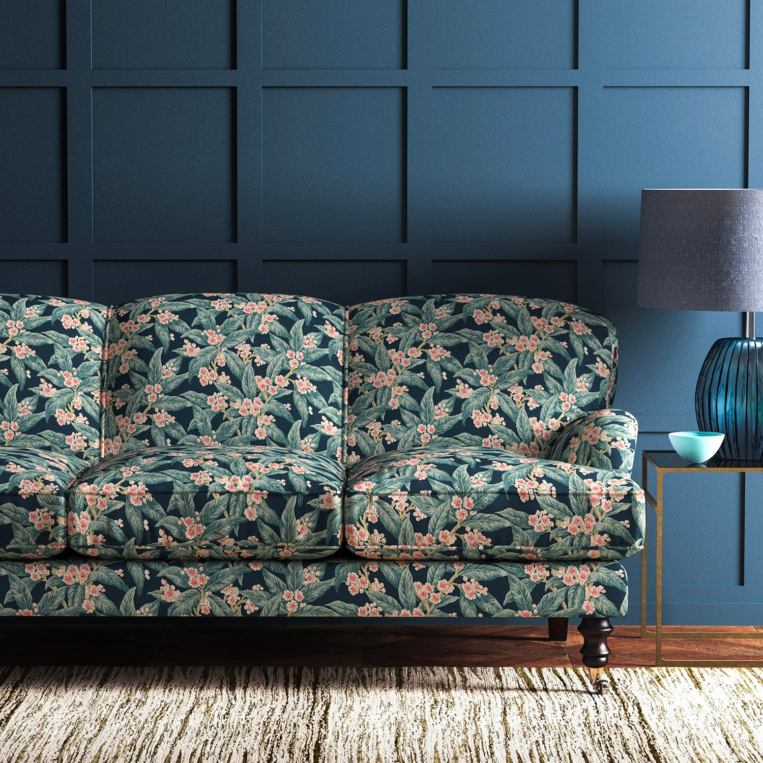 Velvet sofa upholstered in a blue leaf and blossom velvet upholstery fabric with a stain resistant finish