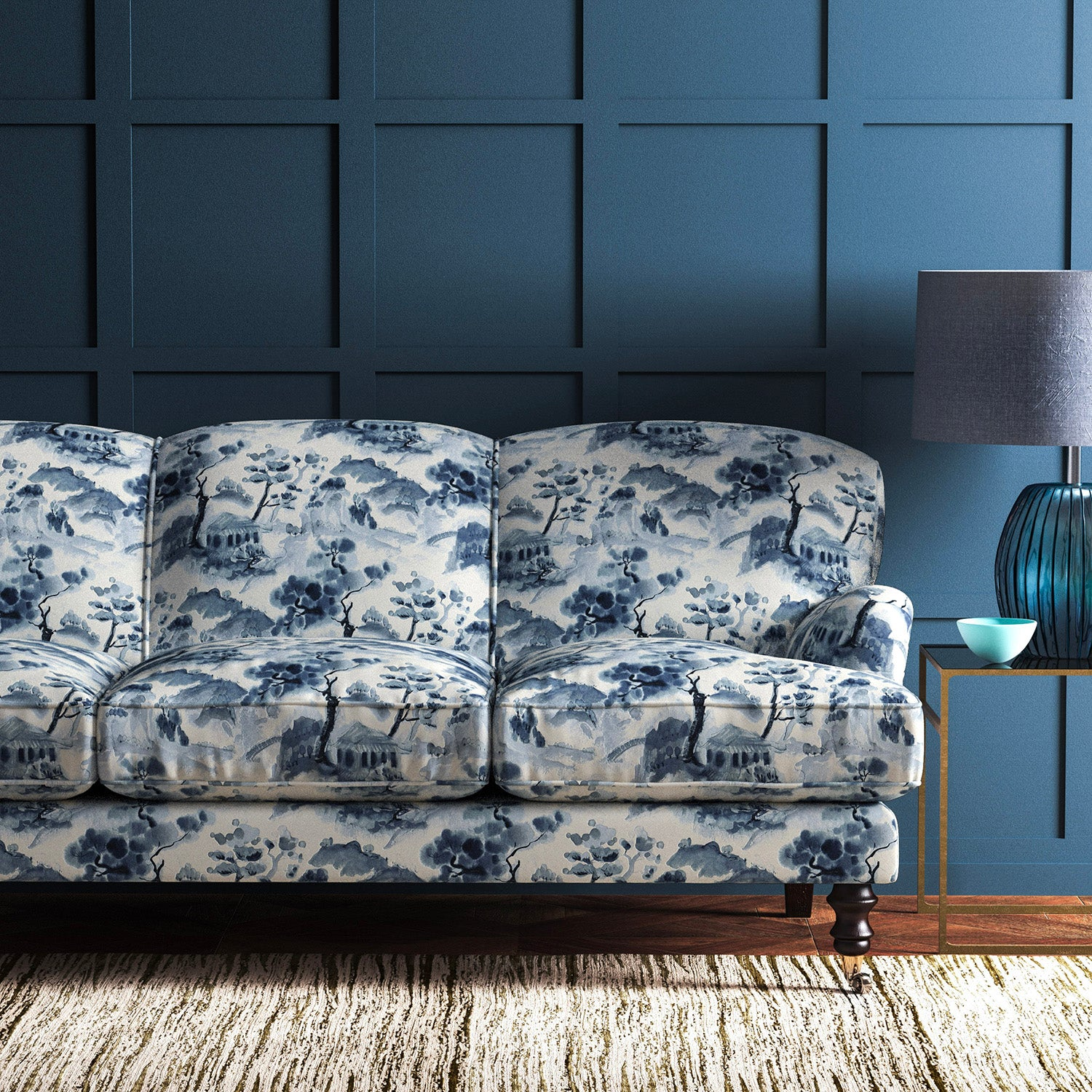 Velvet sofa upholstered in a white and ink blue velvet upholstery fabric with a oriental house design