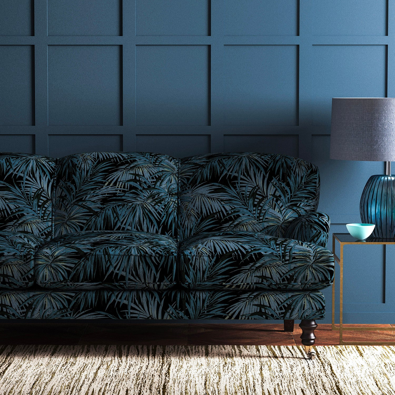 Velvet sofa upholstered in an smokey blue velvet upholstery fabric with palm design and stain resistant finish