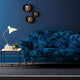 Velvet sofa upholstered in an electric blue velvet upholstery fabric with palm leaf design and stain resistant finish