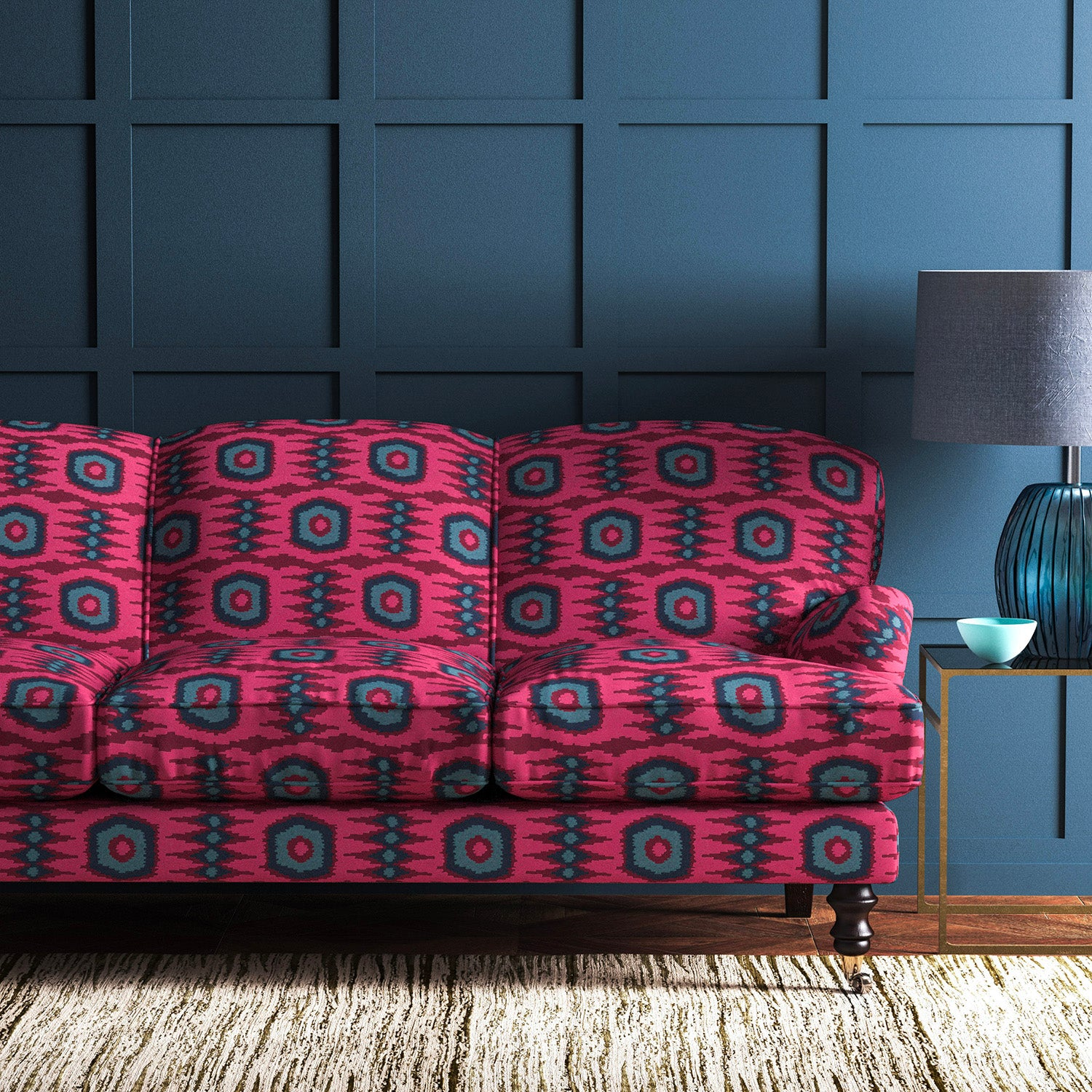 Velvet sofa upholstered in a pink and blue velvet upholstery fabric with abstract print and stain resistant finish