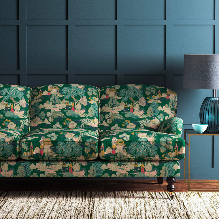 Velvet sofa upholstered in a green velvet upholstery fabric with Japanese inspired design and stain resistant finish