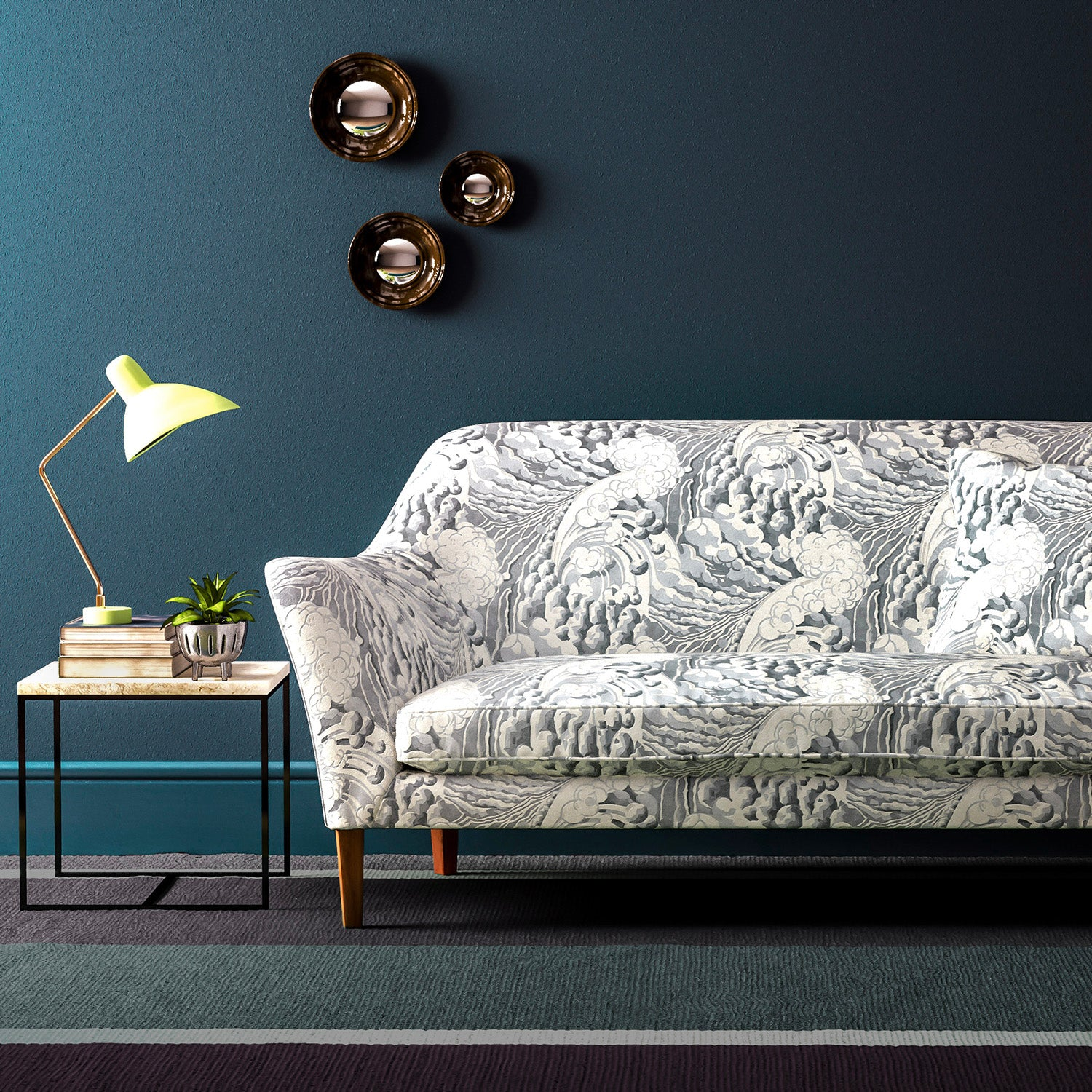 Sofa upholstered in a grey and white velvet upholstery fabric with a wave design and stain resistant finish