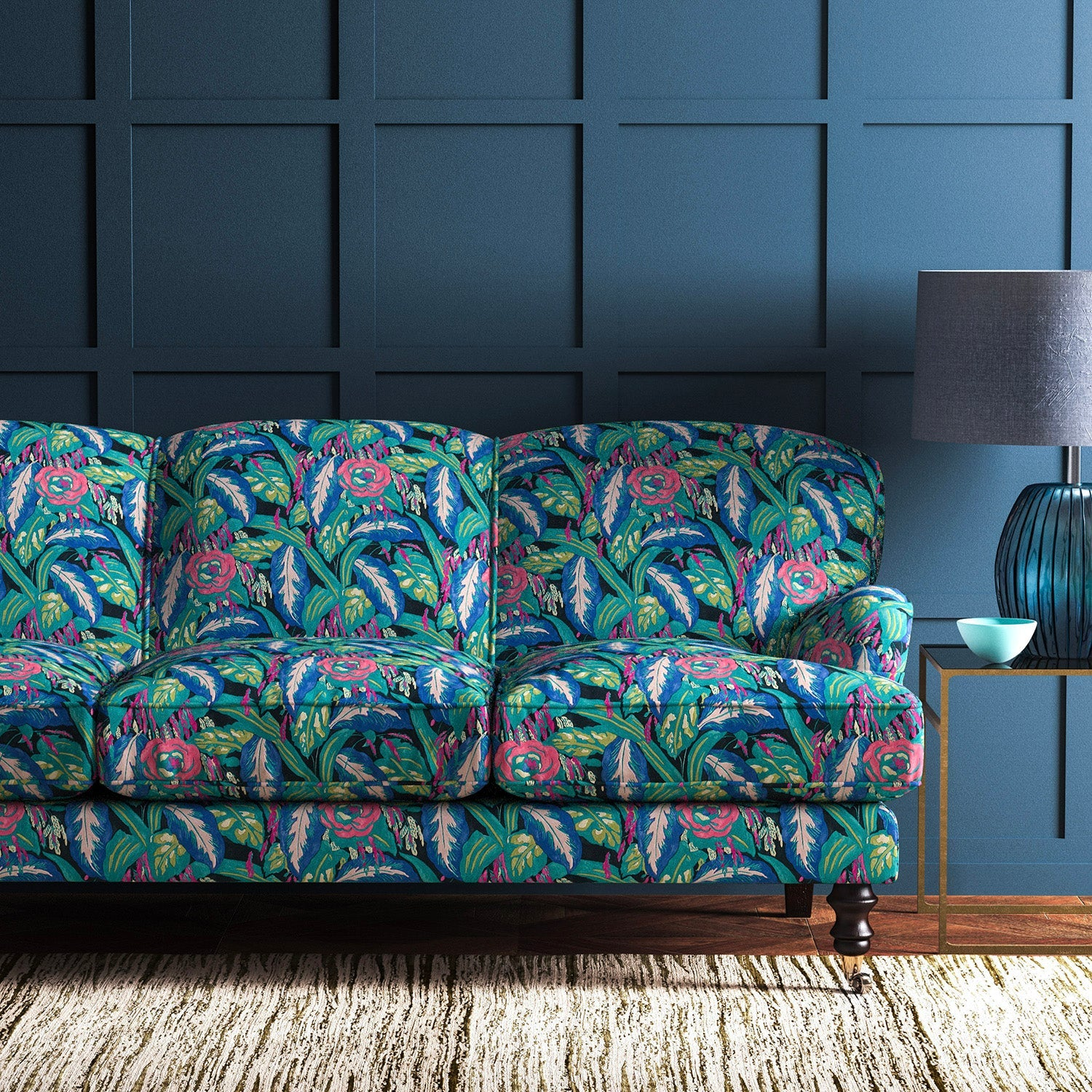 Velvet sofa upholstered in a pink and bright blue floral velvet upholstery fabric with a stain resistant finish
