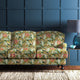 Velvet sofa upholstered in a pink and olive green floral velvet upholstery fabric with a stain resistant finish