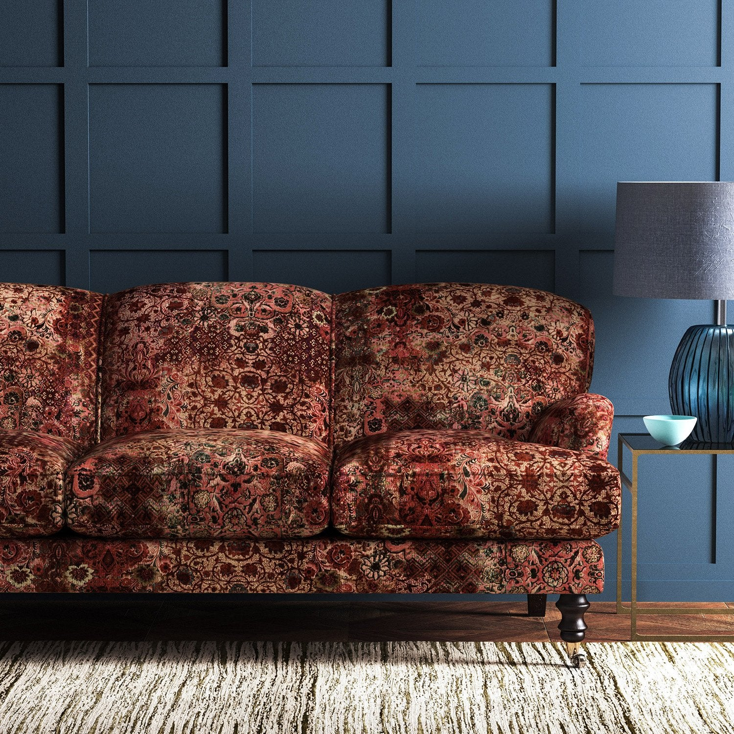 Velvet sofa in a fabric with a carpet design in rich terracotta tones