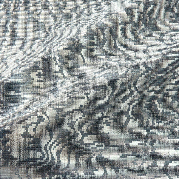 Fabric swatch of an abstract weave design in a grey colour, suitable for curtains and upholstery