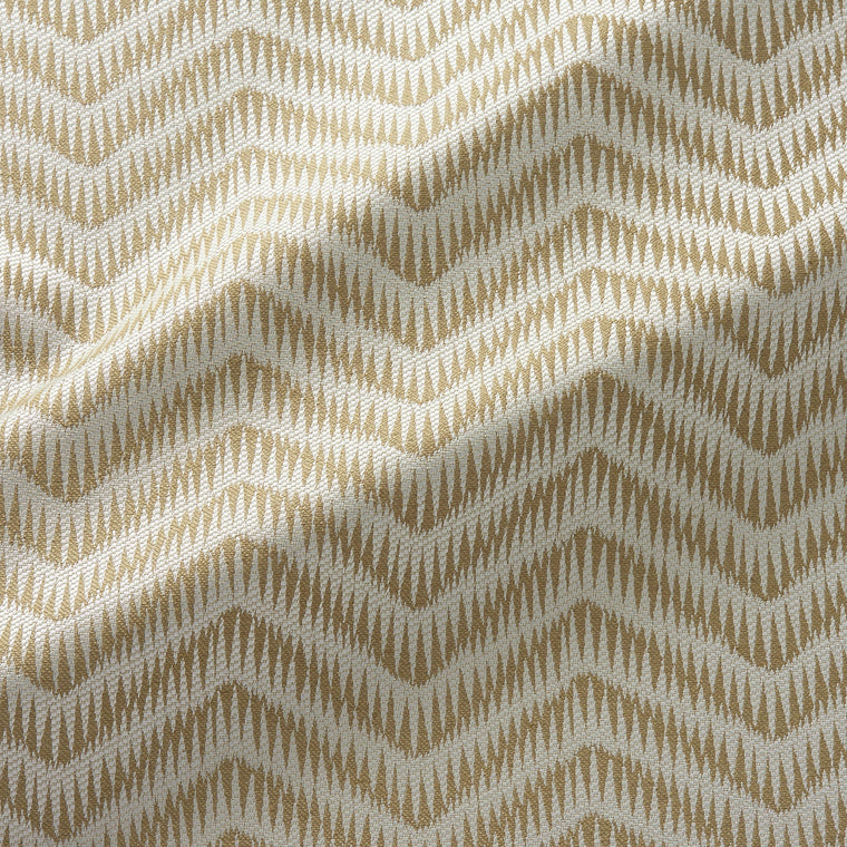 Fabric swatch of a herringbone weave design in a gold colour, suitable for curtains and upholstery