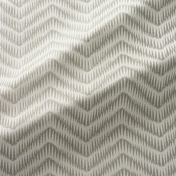 Fabric swatch of a herringbone weave design in neutral colours, suitable for curtains and upholstery
