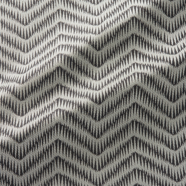 Fabric swatch of a herringbone weave design in a grey colour, suitable for curtains and upholstery