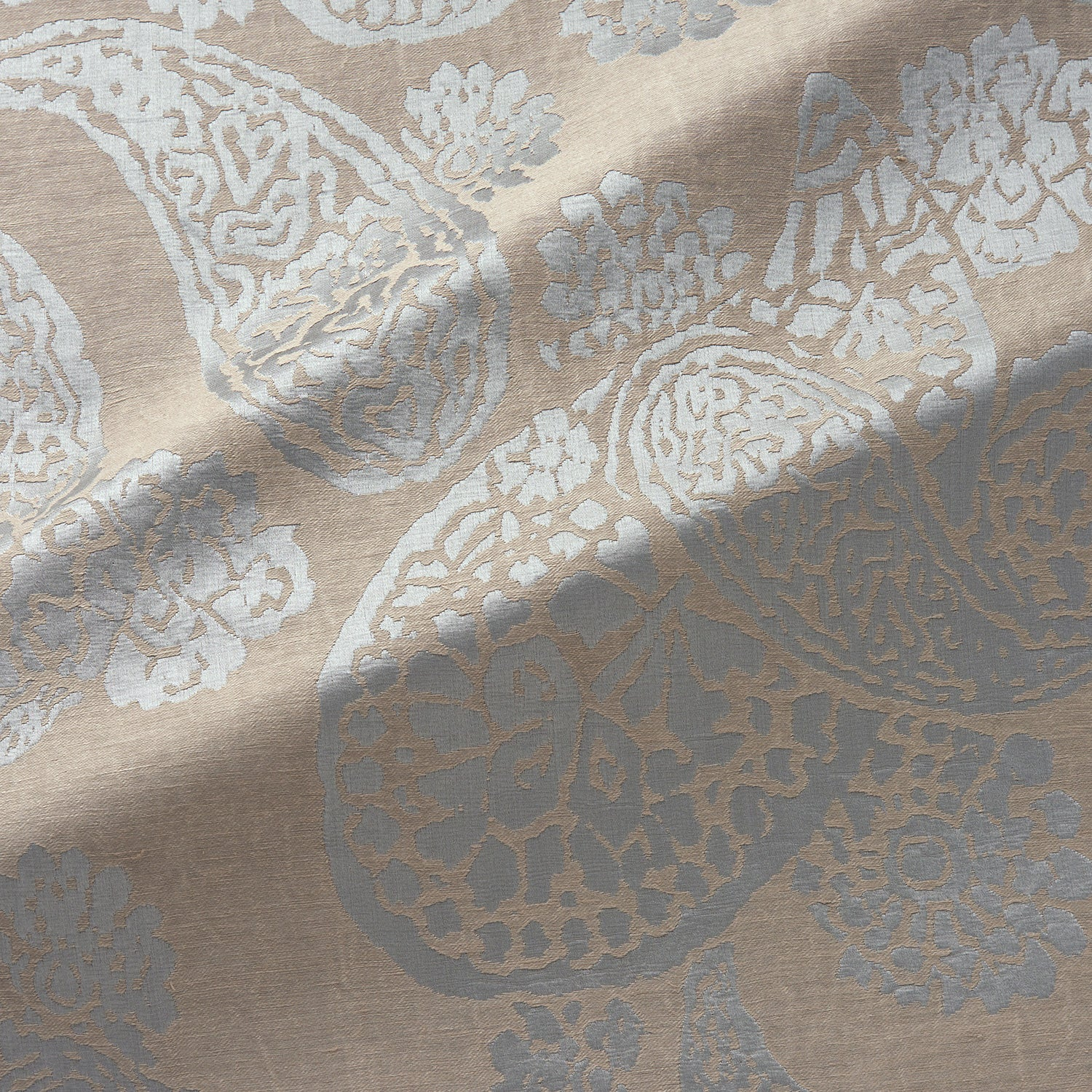 Fabric swatch of a silk and linen paisley design fabric in dark neutral colours, suitable for curtains