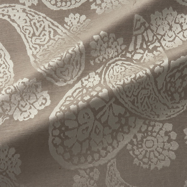 Fabric swatch of a silk and linen paisley design fabric in neutral colours, suitable for curtains