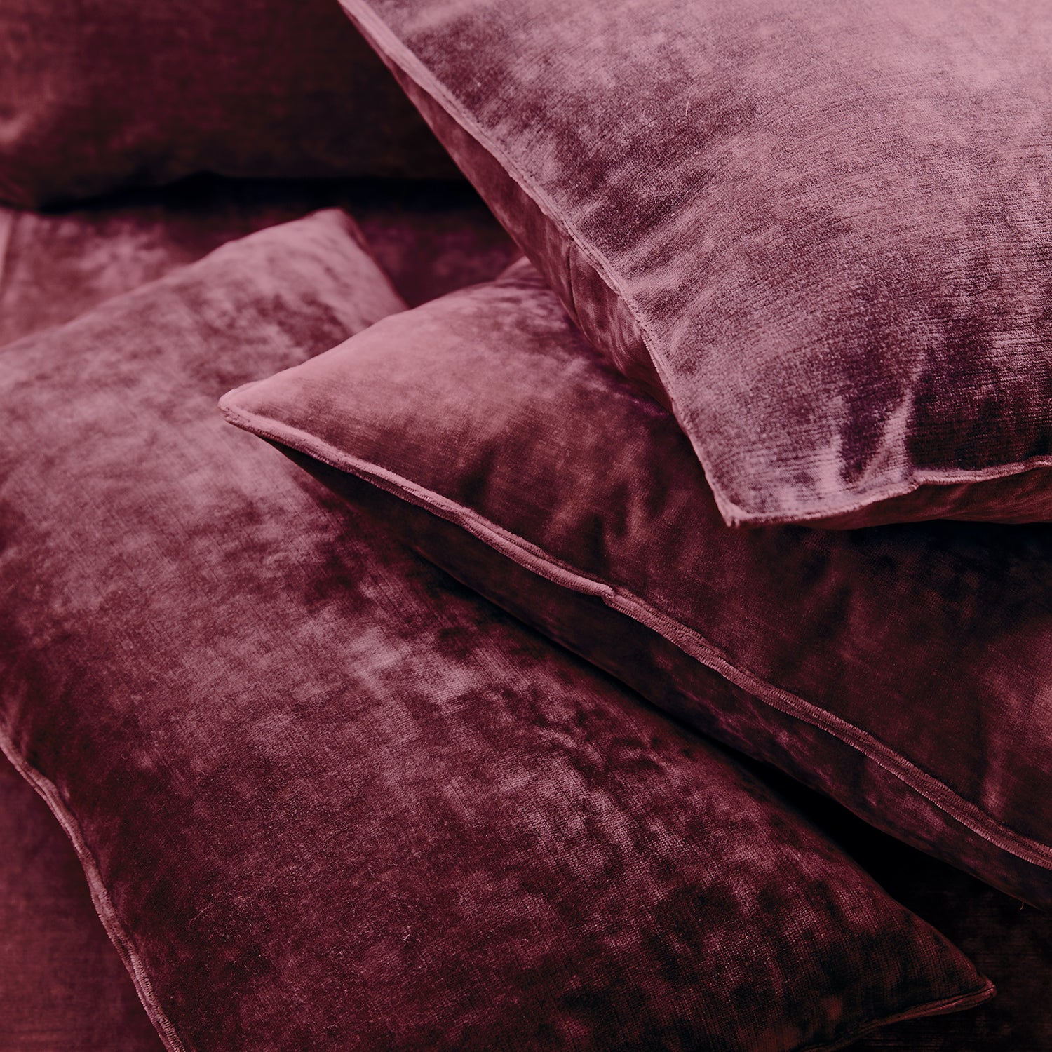 Cushions in a berry coloured stain resistant crushed velvet fabric, perfect for berry crushed velvet sofa or curtains