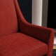 Chair upholstered in a bright red herringbone wool weave upholstery fabric