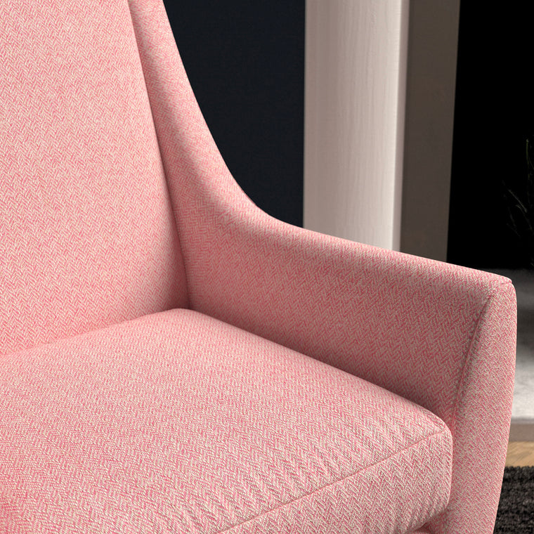 Chair upholstered in a candy pink herringbone wool weave upholstery fabric