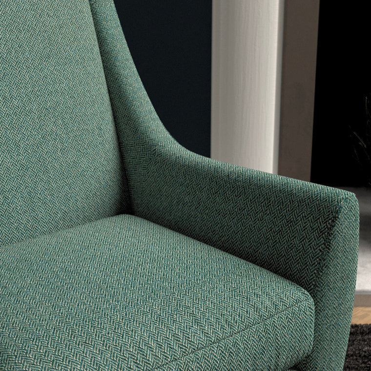 Chair upholstered in a seagreen herringbone wool weave upholstery fabric