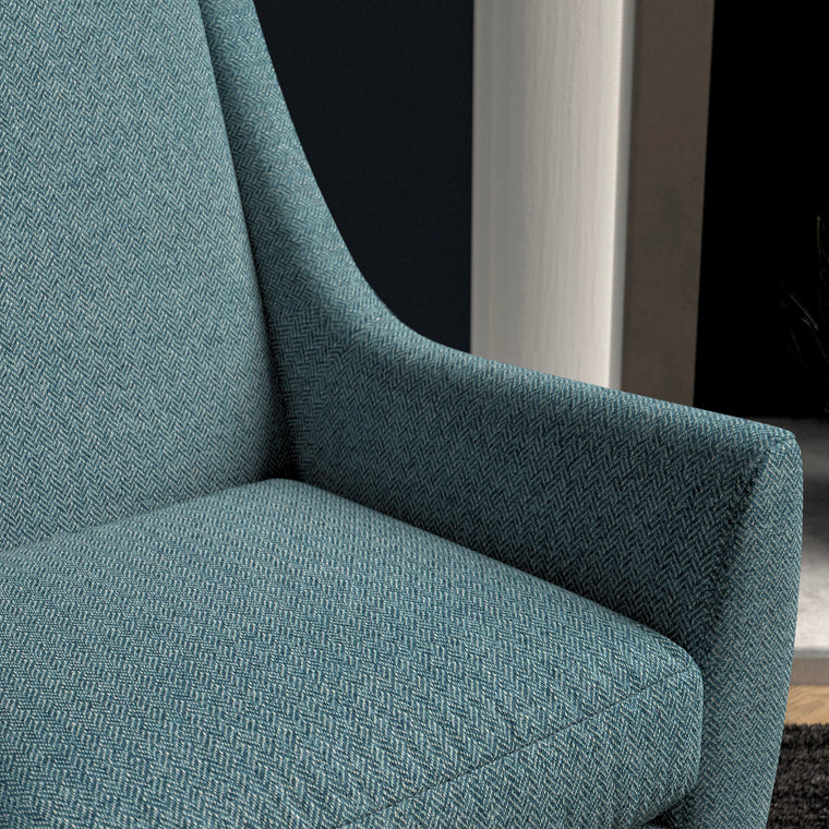 Chair upholstered in a blue herringbone wool weave upholstery fabric